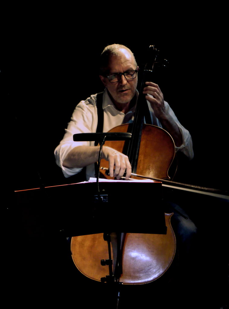 Ivan playing the cello in the dark